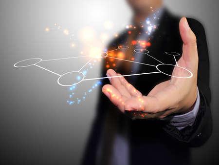 dotykový displej: Ruka držící síť Reklamní fotografie