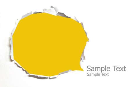 worn paper: El papel roto con el fondo amarillo Foto de archivo
