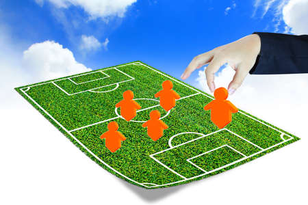field study: soccer manager drawing a tactical plan  Stock Photo