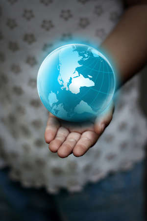 hand holding globe: Hand holding the blue Earth  Stock Photo