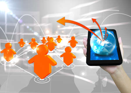 Businessman holding world .Technology social network concept  photo