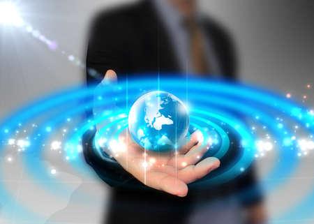 businessman holding globe glowing photo
