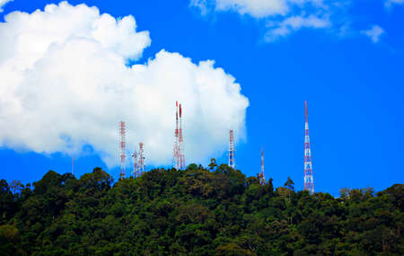 communications tower: Power transmission towers on the hill  Stock Photo