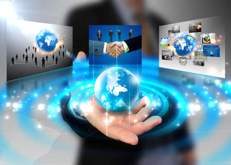 connected world: businessman holding business world Stock Photo