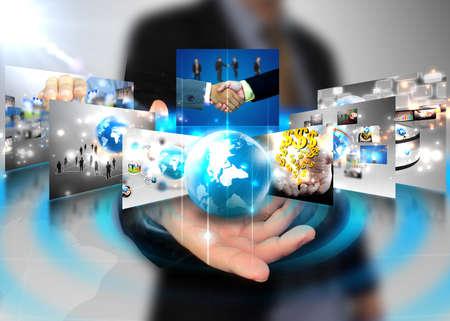 tecnologia: businessman holding mondo degli affari