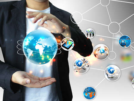 social event: businessman holding business world Stock Photo