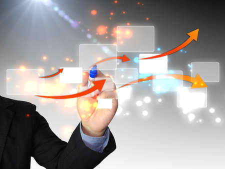 businessman drawing business diagram photo