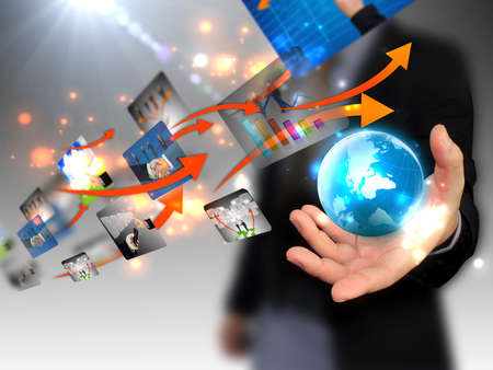 design solutions: businessman holding world, connected  Stock Photo