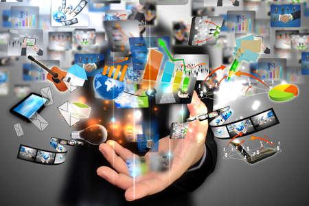 multimedia icons: Businessman holding social media  Stock Photo
