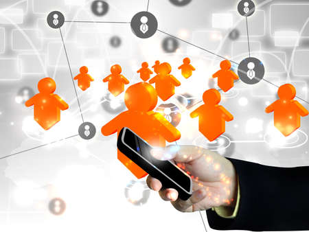Businessman holding social network on smart phone .Technology concept  Фото со стока