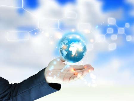 global partnership: businessman holding globe, connected