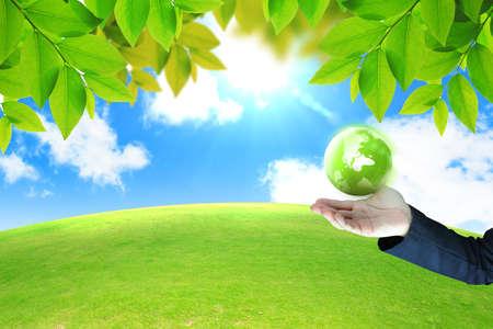 global village: hand holding green globe  Stock Photo