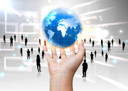 economia: holding mano mundo de los negocios Foto de archivo