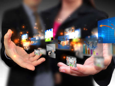Business people holding social media Stock Photo - 18952533