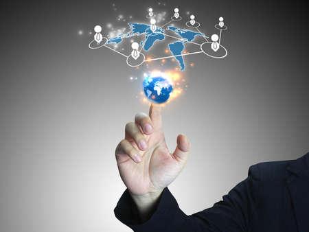 Businessman touch world button interface.technology concept  photo