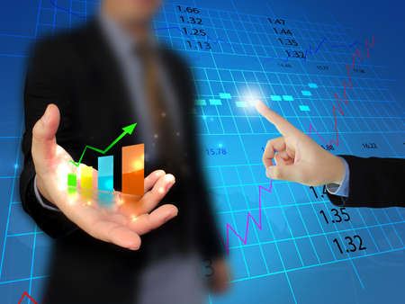 Businessman holding business graph  Stock Photo - 21916267