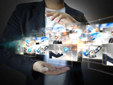 communication: businessman holding business world  Stock Photo