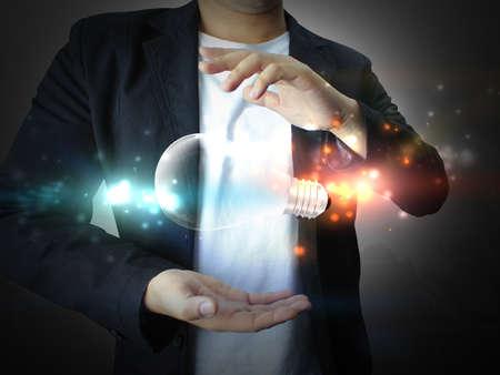 energia electrica: idea holding empresario Foto de archivo