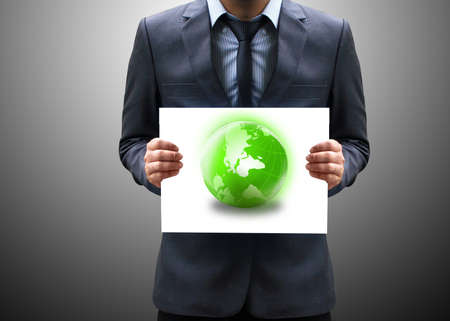 world village: businessman holding green globe  Stock Photo