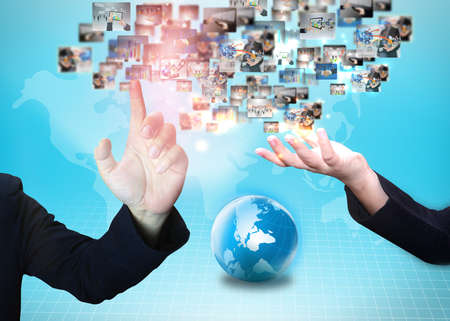 Business people holding business world Stock Photo - 23689246