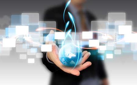 Businessman holding Business-Welt Lizenzfreie Bilder