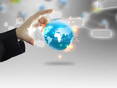 businesses: Businessman holding business world globe