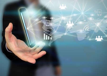 mobile marketing: businessman holding social network concept.