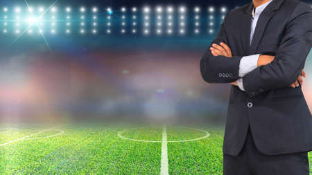 Football manager with soccer field and bright spotlights.  photo