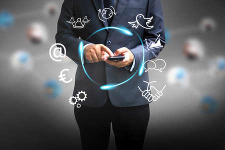 Businessman using a smart phone.  photo