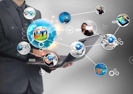 marketing research: Businessman holding social media concept.