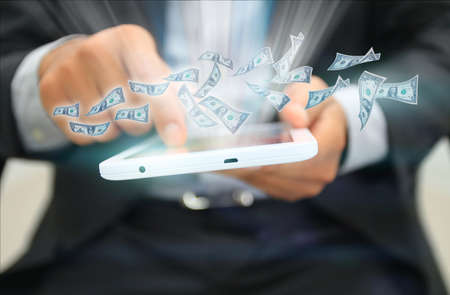 transferring: Dollars flying out of the tablet.business concept Stock Photo