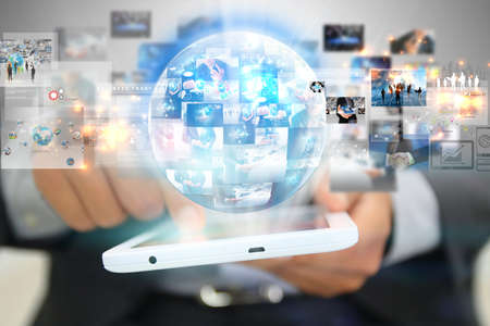 Media: Businessman holding social media concept.