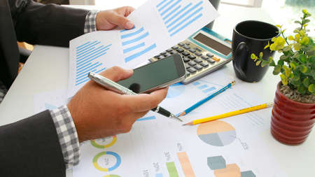 financial paperwork: Businessman analysis financial paperwork and reports, graph, planning,working at office desk.