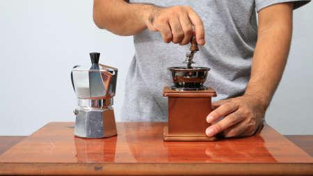 grinder: Man take coffee grinder.