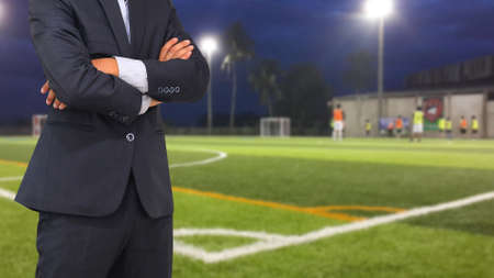 Football manager with soccer field and bright spotlights. Reklamní fotografie - 50534545