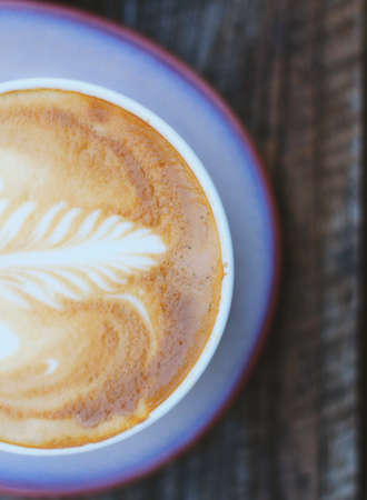 top: Cappuccino. Coffee cup top view