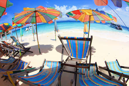 Beach chairs with umbrella and beautiful beach. Stock Photo