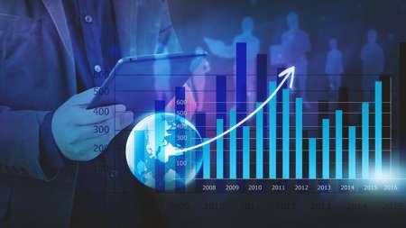 Businessman analysis financial graph,business graph background Standard-Bild