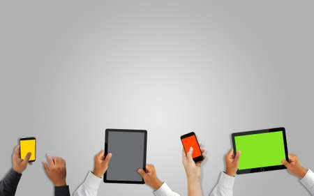 blank tablet: Hand holding mobile smart phone and tablet with blank screen.