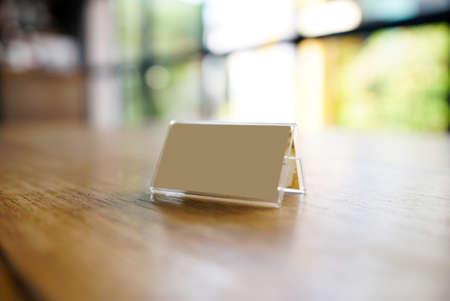 talker: Mock up Menu Frame template on table in coffee shop.