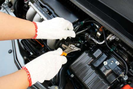 budget repair: mechanic repairs a car.