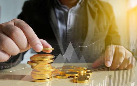Businessman putting money coins. Business Growth concept.