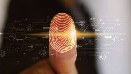Businessman login with fingerprint scanning technology. fingerprint to identify personal, security system concept                                     Stockfoto