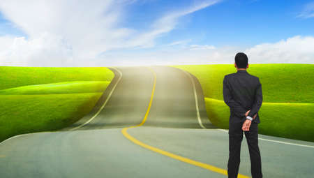 businessman standing and looking on the road. road to success concept. Stock Photo