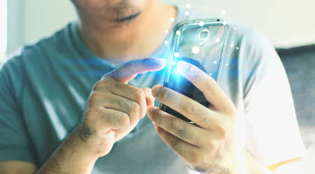 input device: Businessman touching screen on smartphone with global network.