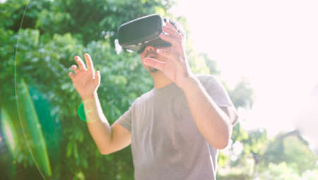 Young man wearing virtual reality glasses. Virtual reality concept, Smartphone and VR headset