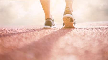 Runner athlete feet running on treadmill. workout wellness concept. Stock Photo