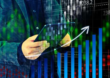 Businessman analysis report graphs   Imagens