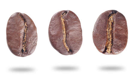 fresh roasted coffee beans isolated on white background. Фото со стока