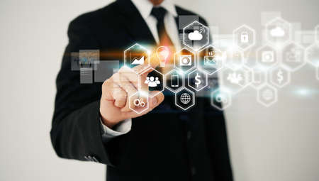 Businessman touching social icon. Social media concept Фото со стока